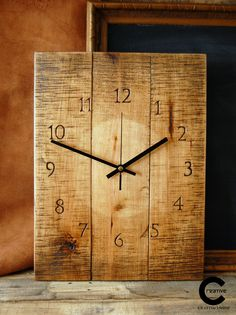 Shaded pallet wood wall clock. Handcarved numerals. www.etsy.com/shop/CraftyIsland