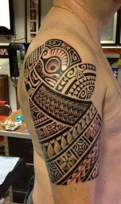 Polynesian arm tattoo.