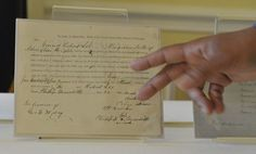 Damani Davis, an archivist with the National Archives, discusses original records pertaining to the District of Columbia Compensated Emancipation Act. In commemoration of the 150th anniversary of the act, the National Archives shared rarely seen original records pertaining to the act, including petitions from slaves, with the media.