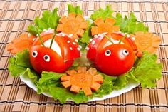 Carving from lettuce and tomato in form ladybird  Stock Photo