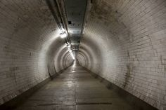 Tunnel - The long tunnel, only strip lighting always threatening to go out causes a fear of the dark which has inhabited humans as a natural instinct. This instinct comes from fear of nocturnal predators. (timeout, 2013)