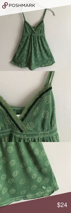 Abercrombie & Fitch dotted print tank Abercrombie & Fitch green dotted print cotton tank w/lace & velvet trim, ties in back, adjustable straps - perfect condition never worn Abercrombie & Fitch Tops Tank Tops