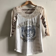 """Free People Top  Fun and super soft We The Free to by Free People with """"Great Falls, Montana"""" and image on front with crocheted neck and arm accents and stripes on back.  Some pilling under arms but in otherwise in good gently used condition. Free People Tops"""
