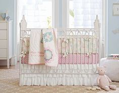 These fabrics, crib ruffle, curtains and room color are beautiful. I like this room a lot. Not to mention the crib!