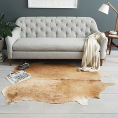 Cowhide Rug #westelm GREAT COLOR.. COULD ALSO LOOK FOR ONE WITH COOL TONES. CAN BE USED IN EITHER ROOM.