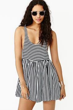 Winona Stripe Dress by Friend of Mine | Way cute babydoll dress featuring a deep scoop neckline and black and white stripe print. Pleated detailing, oversized armholes. Unlined. Looks perfect paired with circle shades and wedges!