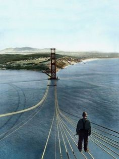 A fearless worker standing on the unfinished Golden Gate Bridge, 1935.