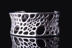Bamboo Cuff - sterling silver by Nervous System.  lost wax casting from 3d-printed wax  Cell Cycle collection by Nervous System. Inspired by the microscopic glass skeletons of radiolarians.