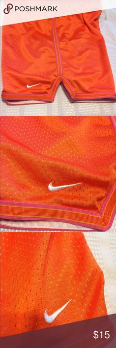 Nike athletic shorts size medium. Nike brilliant orange perforated athletic shorts fully lined, drawstring waist, trimmed in pink and orange in excellent condition I have 3 of these in medium 1 in small if interested in bundling I will give you a great deal. Nike Shorts