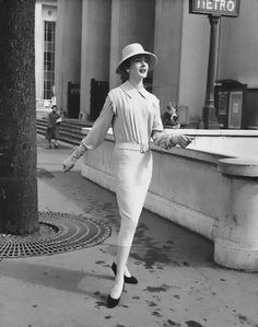 A model wears a Fath design, adapted for the popular market by Frank Usher. Paris, 1955