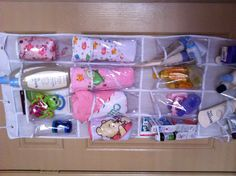 Organize baby stuff with a door shoe rack. Great for all those loose, smaller items.
