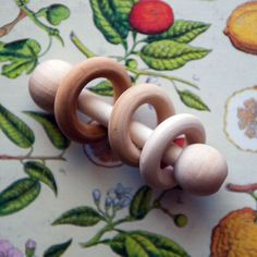 Learn how to make this montessori baby rattle with just a few supplies.