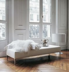 I absolutely love a rustic herringbone floor in an all white Parisian inspired interior.