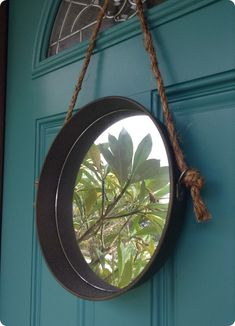 DIY Home Decor | All you need is a cake pan and rope to make this Restoration Hardware knock off wall mirror!