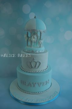 dreamy pastel blue and silver carousel horse, royal prince theme cake for a 1st year old celebration.