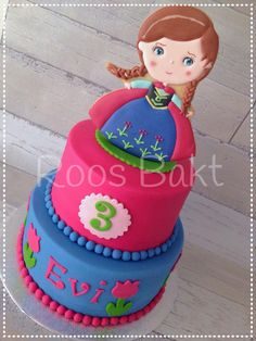 Frozen Anna cookie on top of a cake