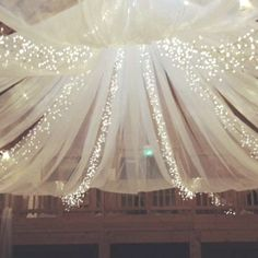 lights and tulle to make magical ceilings for parties... love it for outdoors