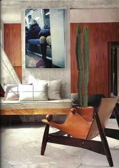 Decor Lina Bo Bardi, leather and rosewood chair, ca. Photo and interior by Luciana Penna. / Luciana Penna - Info Colors Dimensions Materials The Eames Lounge Chair