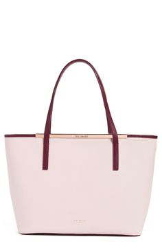 Spotted the perfect stylish pink and oxblood tote at the Anniversary Sale to keep all of the daily essentials close by while out and about. Love that it also comes with a floral detachable pouch to hold smaller items.