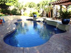 free form pool with raised seating/wall