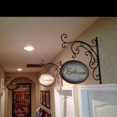 Hobby Lobby brackets (on sale, of course), oval pine plaques, a little spray paint and vinyl letters cut from my Silhouette