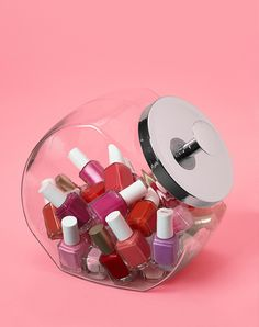 Instead of hiding them in a drawer or banishing them to a box, put all of your fancy polishes in a see-through cookie jar. Maybe next time you head out to get a manicure, you'll actually remember to bring your own polish.
