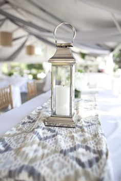 silver lantern and ikat centerpiece. Could be lovely!