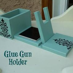Glue Gun Holder with attached glue box. $16.99, via Etsy. -  I so want one of these!