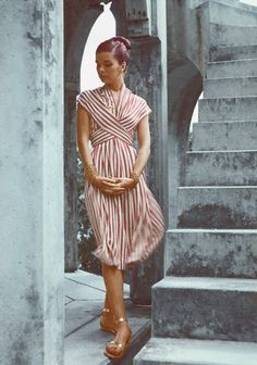 1946 Model is wearing a striped wrapped Empire dress of rayon jersey by Mildred Orrick