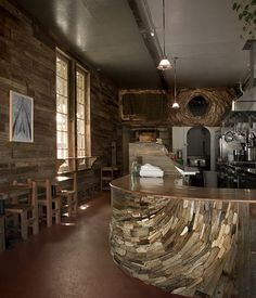 The rustic wooden interior of San Francisco's Outerlands is as much of a draw to the celebrated Outer Sunset eatery as its famous loaves of bread, which are baked in-house, daily.  Photo by Barret Gentz.