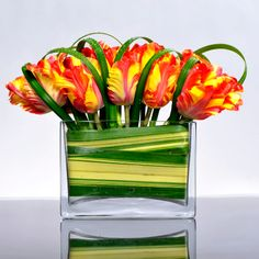 Create a visual dynamic by thinking about what's in the vase as much as what's above the vase!