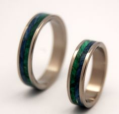 Tidal Pull. Blue and Green Box Elder wood natural compliment eachother in this Earth-toned titanium band. Polished with a mirror finish. Pictured at 4.8mm.