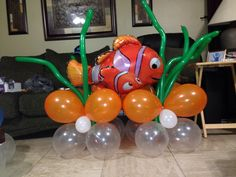 I like the idea of using the green thin balloons for underwater plants.  And, I already bought the Nemo balloon!  I wonder if I could do a whole bunch of green to look like their home.