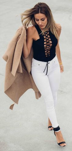 This edgy black lace top looks hot with skinny white jeans. Via Sendi Skopljak.  Top: Chicy, Jeans: Dr denim, Coat: Zara, Shoes: Mango.