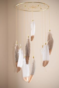 This gorgeous baby dream catcher mobile will make all your dreams come true :) This dream catcher mobile can be hung over a crib, changing