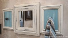 With a little love, these out-dated thrift store frames and mirror make for the perfect towel holder!