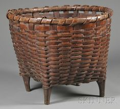 Footed Splint Wool-gathering Basket, America, century, large round over square form with two handholds, supported on four carved fee