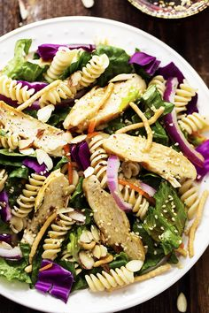 A delicious and flavorful salad that is packed with leafy romaine, red cabbage, chicken, carrots, and almonds. The pasta adds a unique and perfect texture and the sesame dressing is perfect on top! I love a good salad. Can you tell? I have been trying to post one once a week and I make them …
