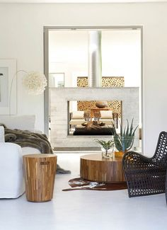 Love these elements - accent tables, lamp, fireplace and far cubby filled with wood - South Africa