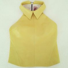 Andra Andreescu yellow leather crop top