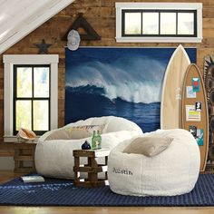 Surf/beach themed room! Love the picture behind the bed. #surfboard #beach #surf