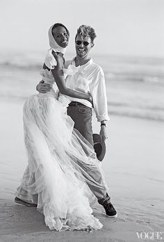 Iman, in a dress by Karl Lagerfeld for Chanel Haute Couture, and David Bowie on the beach at Cape Point Nature Reserve near Cape Town, South Africa.