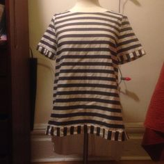 Anthropologie high-low striped top. High low with cute side detail. Striped navy and white and all white on the back. Anthropologie Tops