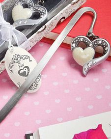 Heart-within-a-heart bookmark. http://www.bluerainbowdesign.com/WeddingFavorProduct.aspx?ProductID=PR05261217499900123456789XBRD10182