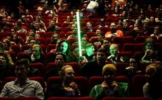 STAR WARS: A fan waits with his light sabre for the start of the movie premiere of Star Wars: The Force Awakens in Helsinki, Finland. Photograph: Outvesa Moilanen/AFP/Getty Images