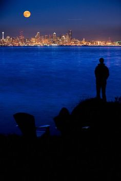 A beautiful view of Seattle across Puget Sound from Bainbridge Island - A short ride away from Seattle by ferry this island was named the second-best place to live in the United States by CNN/Money and Money magazine