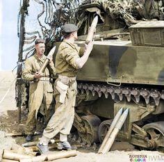 75mm HE (high explosive ) shells being loaded into a Sherman tank of the Royal Tank Regiment, in use in the indirect artillery role in the Anzio bridgehead, 5 May 1944.