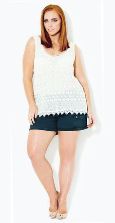 Show off those lovely legs with a pair of cute cargo shorts paired with a very feminine top.