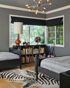 Holly Bender Interiors: Boys' bedroom for two with charcoal gray paint color, black roman shades covering ... or guest room