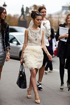 Love the feathered skirt.